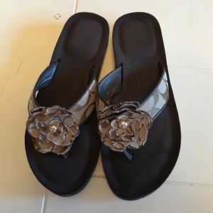 Coach brown flip flops with flower size 6
